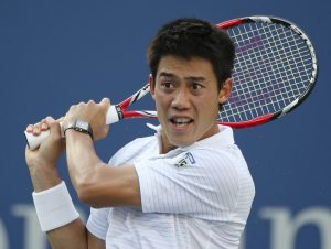 Kei Nishikori, of Japan, returns a shot to Stan Wawrinka, of Switzerland, during the quarterfinals of the 2014 U.S. Open tennis tournament, Wednesday, Sept. 3, 2014, in New York. (AP Photo/Mike Groll)